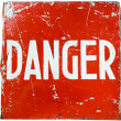 "Word "" danger "" on red shield — Stock Photo #10138818"