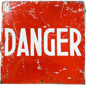 "Word "" danger "" on a red shield — Stock Photo"