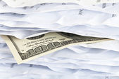 100 bill in the paper chaos — Stock Photo