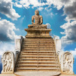 Statue of a meditating Buddha against the sky. A collage of many - Stock Photo