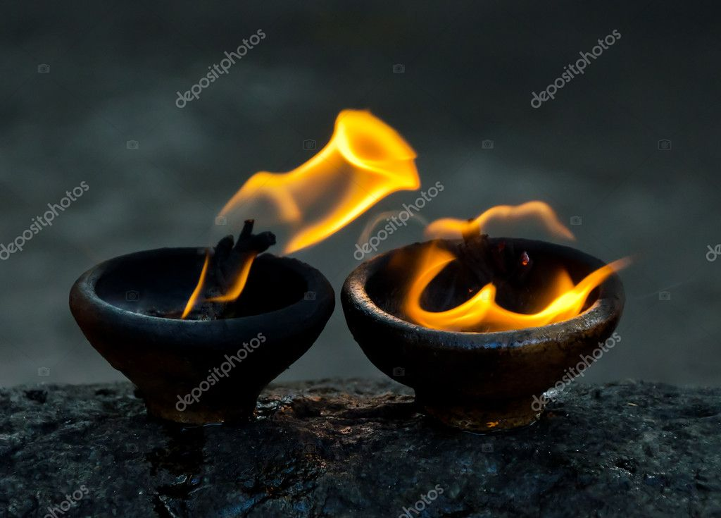 Sacred fire, coconut oil lamps in a buddhist temple — Stock Photo #9205678