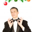 The happy New Year's man in a classical tuxedo - Stock Photo