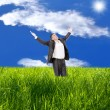 Happy man over green field — Stock Photo
