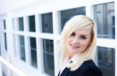 Attractive blonde woman with window — Stock Photo