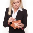 Woman holding piggy bank with a plaster — Stock Photo #10342787