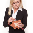 Woman holding piggy bank with a plaster — Stock Photo