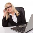 Businesswoman in glasses working — Stock Photo