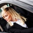 Smiling woman driver at wheel of car — Stock Photo #10343127