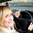 Smiling woman driver at wheel of car — Stock Photo