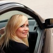 Smiling woman driver at wheel of car — Stock Photo #10343167