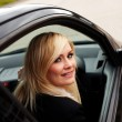 Smiling woman driver at wheel of car - Foto Stock