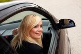 Smiling woman driver at wheel of car — Stock Photo