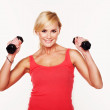 Fit woman lifting dumbbells — Stock Photo