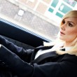 Beautiful businesswoman driving a car — Stock Photo
