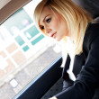 Stock Photo: Beautiful businesswoman driving a car