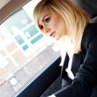 Beautiful businesswoman driving a car — Stock Photo #10461890