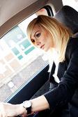 Beautiful businesswoman driving a car — Stock Photo