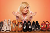 Beautiful Blonde making a deccision about shoes — Photo