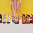Shapely legs and shoes on display — Stock Photo #10478085