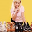 Blonde lady with a passion for shoes — Stock Photo