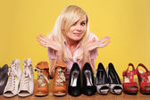 Pretty blonde undecided on which shoes to wear — Stock Photo