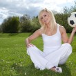 Pretty woman holding a football — Stock Photo #10558285