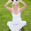 Pretty woman holding a football — Stock Photo