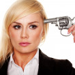 Woman holding a gun to her head - Stock Photo