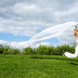 Woman running with white scarf — Stock Photo #10628020