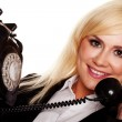 Woman chatting on an old fashioned telephone — Stock Photo