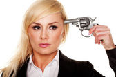 Woman holding a gun to her head — Stock Photo
