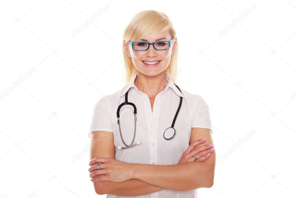 Young blonde attractive doctor with arms crossed isolated on white — Stock Photo #10637409