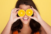 Laughing Woman With Orange Slices Over Eyes — Stock Photo