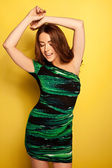 Sensual Woman Dancing In Slinky Green Dress — Stock Photo
