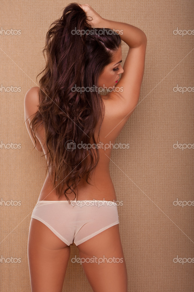Back View Sexy Topless Woman with long hair looking back over her shoulder, studio portrait implied topless. — Stock Photo #8293286