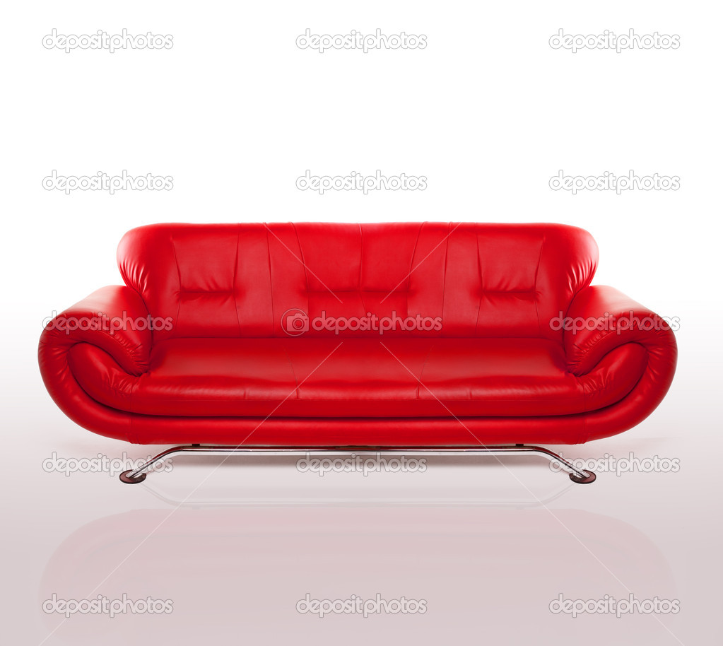 Modern stylish couch with arms and a metal frame upholstered in red leather, studio over white  Stock Photo #8584416
