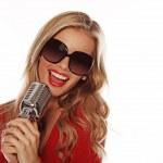 Beautiful Woman Singing Into Microphone — Stock Photo #8711401