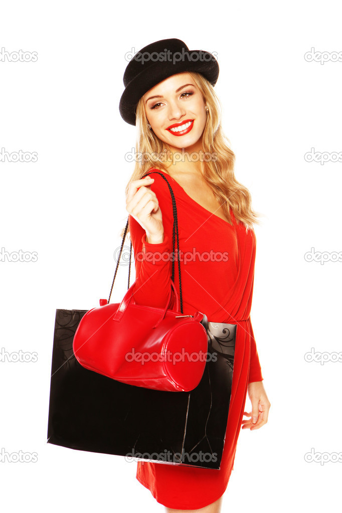 Stunning blonde woman dressed in a trendy red outfit with matching bag and fashionable black hat — Stock Photo #8711899