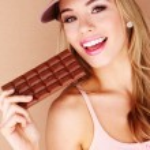 Pretty Woman Holding Chocolate Treat — Stock Photo #8888747
