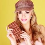Pretty Woman Holding Chocolate Treat — Stock Photo #8901250