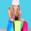 Excited Woman Looking In Shopping Bag — Stock Photo