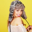 Vivacious Woman In Woolly Winter Hat - Stock Photo