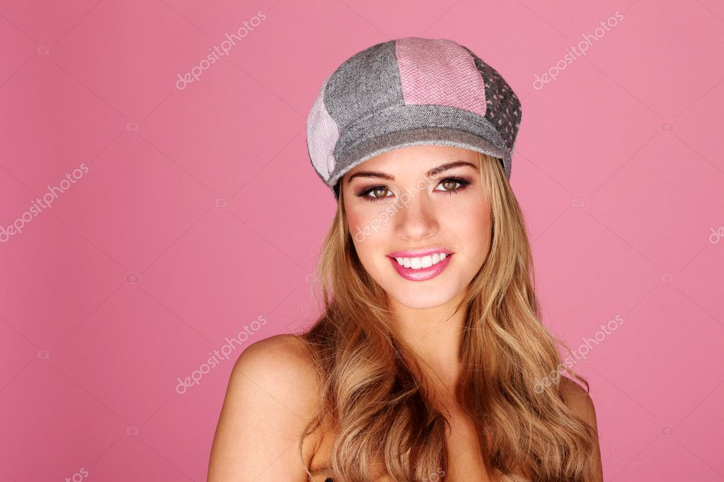 Pretty smiling girl with long blonde hair facing camera, studio portrait on pink. — Stock Photo #9060011