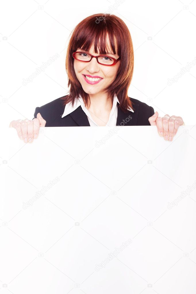 Friendly smiling young businesswoman wearing glasses holding a blank white signboard — Stock Photo #9448386