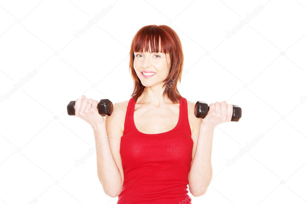 Attractive readhead female lifting weights on white background — Stock Photo #9557098