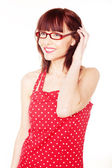 Red haired woman wearing red dress with polka dots — Stock Photo