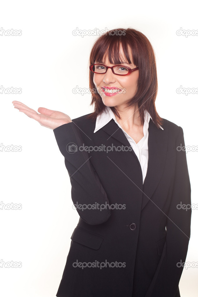 Businesswoman holding up the empty palm of her hand in a business advertising and product placement concept — Stock Photo #9576072