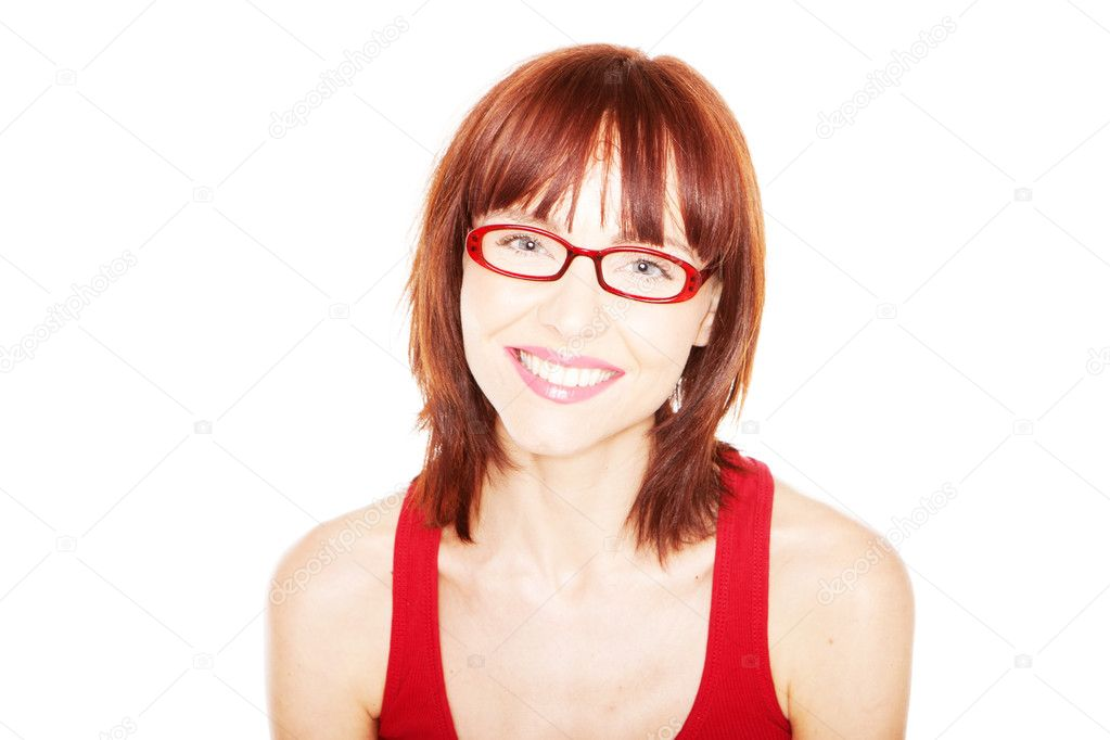 Smiling woman in red tank top and red eyeglasses on a white background — Stock Photo #9578032