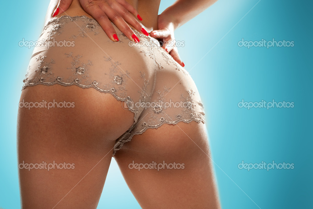 Cropped image of a female model's sexy toned buttocks in see-through panties — Stock Photo #9708230