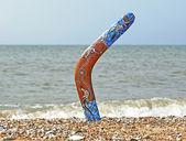 Boomerang on Sandy Beach. — Stock Photo